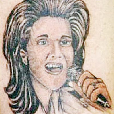 Q103s Featured Image is from the Bad Tattoos of Pop Stars Picture Round